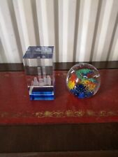 TWO GLASS PAPERWEIGHT, A WORD TRADE CENTRE AND A COLOURFUL ROUND ONE