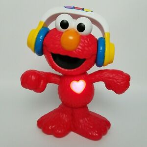 Sesame Street Let's Dance Elmo 12-inch Elmo Toy Sings and Dances 18 mo & Up