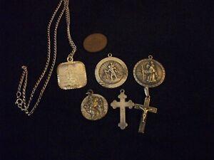 Vintage, silver St. Christopher & cross pendants.