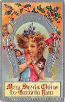 Christmas Postcard Blonde Girl Holding Kitten and Doll, Horseshoe, Drum~108997