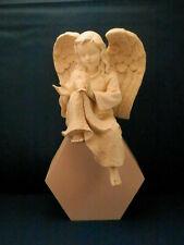 "Ivory Stone Seated Cherub with Dove - 7 1/2"" high"