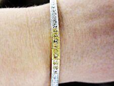Fancy yellow 6.60 CT diamond 32 piece princess white diamond 18 K