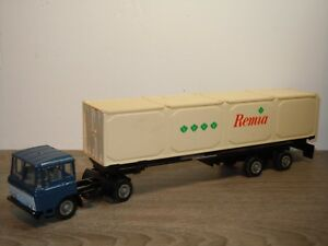 Daf 2600 Truck met Container Oplegger Remia - Lion Car 1:50 Holland *35338