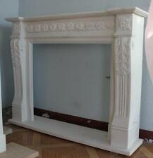 Stunning White Marble Fireplace with Floral Carvings and Fluted Legs