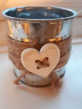 Rustic metal tin with button heart