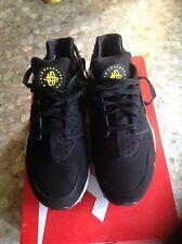Nike huarache nera e gialla taglia 8,5 us (42 eur)