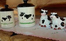 Vintage porcelain ceramic cow canisters with cow sugar and creamer set