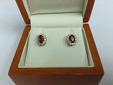Ladies 14k Ruby and Diamond Halo Earrings