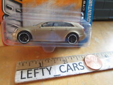 Matchbox Gold Cadillac CTS Wagon MBX ADVENTURE CITY SCALE 1/64 ON LONG CARD
