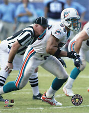 JUNIOR SEAU Unsigned 8x10 Photo MIAMI DOLPHINS