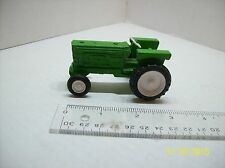 a  1970  green tootsie tractor