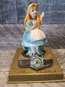 1950's U.S. Time Alice In Wonderland Wristwatch and Porclein Statue