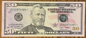 FR#2131-G* $50 2009 FEDERAL RESERVE STAR NOTE - AVE. CONDITION, FOLD IN MIDDLE