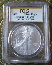 Eight 2005 Gem Brilliant Uncirculated PCGS American Siver Eagles