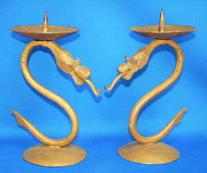 An unusual pair of gold painted metal dragon candlesticks, gothic, medieval