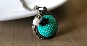 Pave Necklace, Arcrylic Turquoise Cabochon, Bronze, Black Flower Pearl Charm