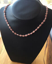 Navajo necklace of rhodochrosite beads interspersed with sterling silver drops