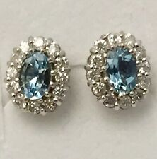 A Stunning Pair Of 18ct Gold Blue Topaz & 0.50ct Diamond Cluster Stud Earrings.