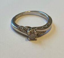9ct white gold Ring -  1/4 carot diamond - size O
