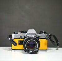 Olympus OM10 35mm Film Camera w/50mm f/1.8 Zuiko & Leather Strap | Serviced