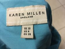 Karen Millen England size UK10 silk skirt side zip wrap belt hankerchief hem