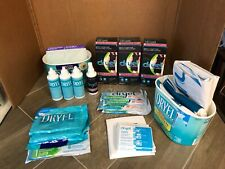 LOT of DRYEL  products...Refills, Absorbent Pads, Cloths, Stain Remover, Bags
