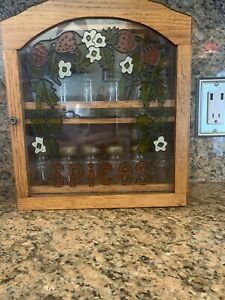 vintage spice cabinet with 12 spice jars