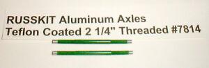 """(2) 2 1/4"""" Russkit Green Teflon Hi-Perf Aluminum 1/8"""" Axles 5:40 Thread  NOS"""