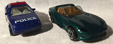 TWO Matchbox , one Police & one Dodge Viper RT/10, new with boxes