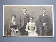 R&L Postcard: Studio Portrait of Edwardian Lady/Gentlemen Burnely