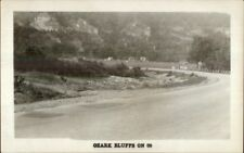 Ozark Bluffs Route 66 Gas Pumps in Distance Real Photo Postcard