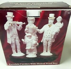 Porcelain Carolers with musical wooden base Gold Accents Galleria Inc Hand made
