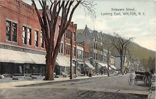 c.1910 Stores Delaware St. looking East Walton NY post card Delaware county