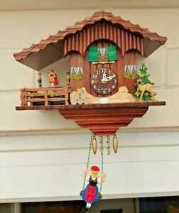 Swiss Chalet Cuckoo style Wall Clock with Rotating Dancers by Trenkle Uhren