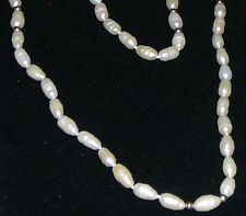Baroque seed pearl and 14K gold endless string sans clasp, vintage 1980