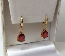 Rose Gold Plated Red Cubic Zirconia Pear Drop Earrings, 27mm x 8mm.