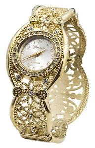 Blekon Collections Quartz Womens 24mm Rhinestone Intricate Concho Bangle Watch