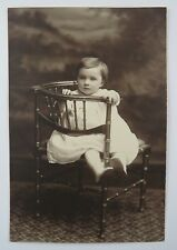 Vintage Studio Portrait Young Girl Sitting on a Bamboo Chair