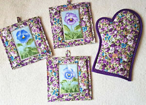 Quilted potholders. Handmade hot pads. Patchwork potholders. Pansy kitchen decor