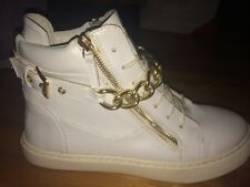 white sneakers with gold chain