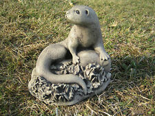 curled otter s stone garden ornament | Many more ornaments in my shop!
