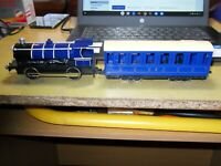 John Lewis toy passenger train. Engine makes sounds and lights up.31 cms long.