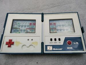 Nintendo Rain Shower Multi screen game and watch, working order.