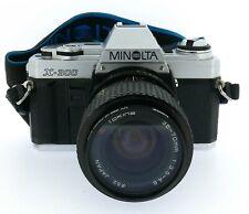 Minolta X-300  con TOKINA 35-70 3.5-4.8 filtro,tappo