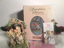 NEW RARE ROMAN SERAPHIM SURROUNDED BY JOY #84898 ANGEL & CHERUB FIGURINE