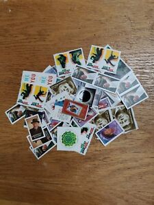 100 USPS mint forever postage stamps of various subjects.