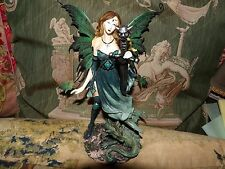 green gothic fairy statue  metal wings and dragon