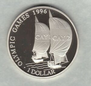 1996 CAYMAN ISLANDS OLYMPIC GAMES SILVER PROOF $1 WITH A CAPSULE.