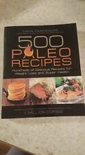 500 Paleo Recipies cookbook by Dana Carpenter  reading  cooking