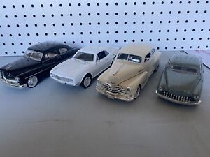 Lot of 4- 1/24 SCALE DIECAST MODEL CARS